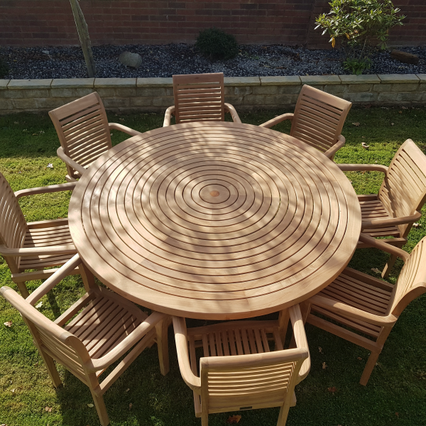 teak round table with 8 stacking chairs